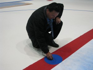 Lewis Staats places the Indian Head Nickel at center ice