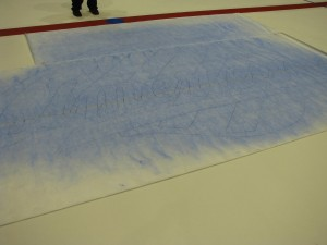 Stencil of Amerks logo being layed out