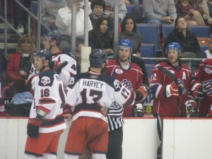 Trevor Gillies exchanging words with Kevin Harvey of the Syracuse Crunch