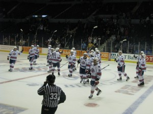 Amerks raise their sticks at center ice after the win